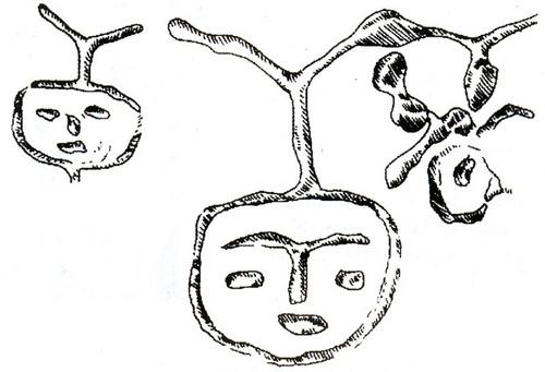 Hình mặt người khắc trên vách hang Đồng Nội